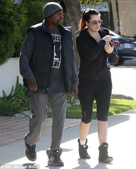 Fighting fit: Khloe met up with her personal trainer today at a LA gym