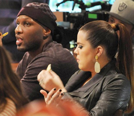 Catching a bite: Later Khloe and Lamar enjoyed a snack while he cameras rolled