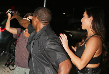 Kanye west trys to take female paparazzi's camera while on date with kim kardashian at the prime 112 in miami beach.