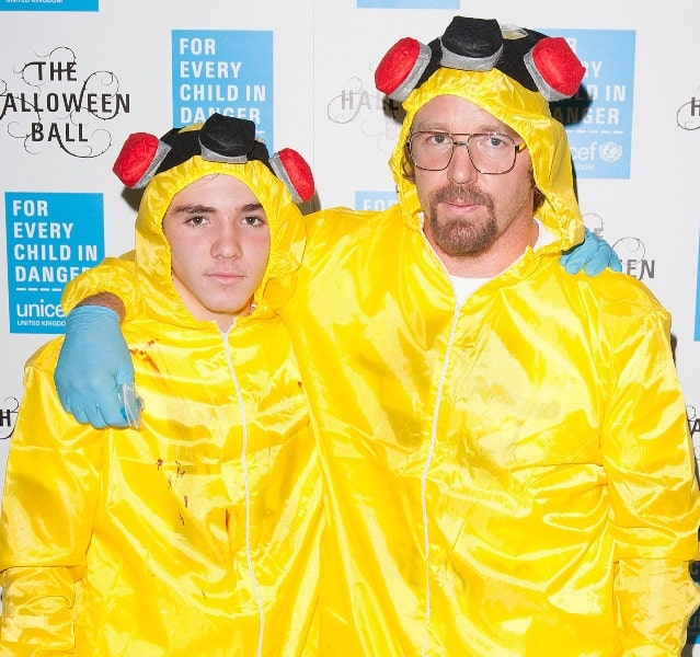 "GUY RITCHIE and his 14-year-old son ROCCO dressed as Walter and Jesse from ""Breaking Bad""."