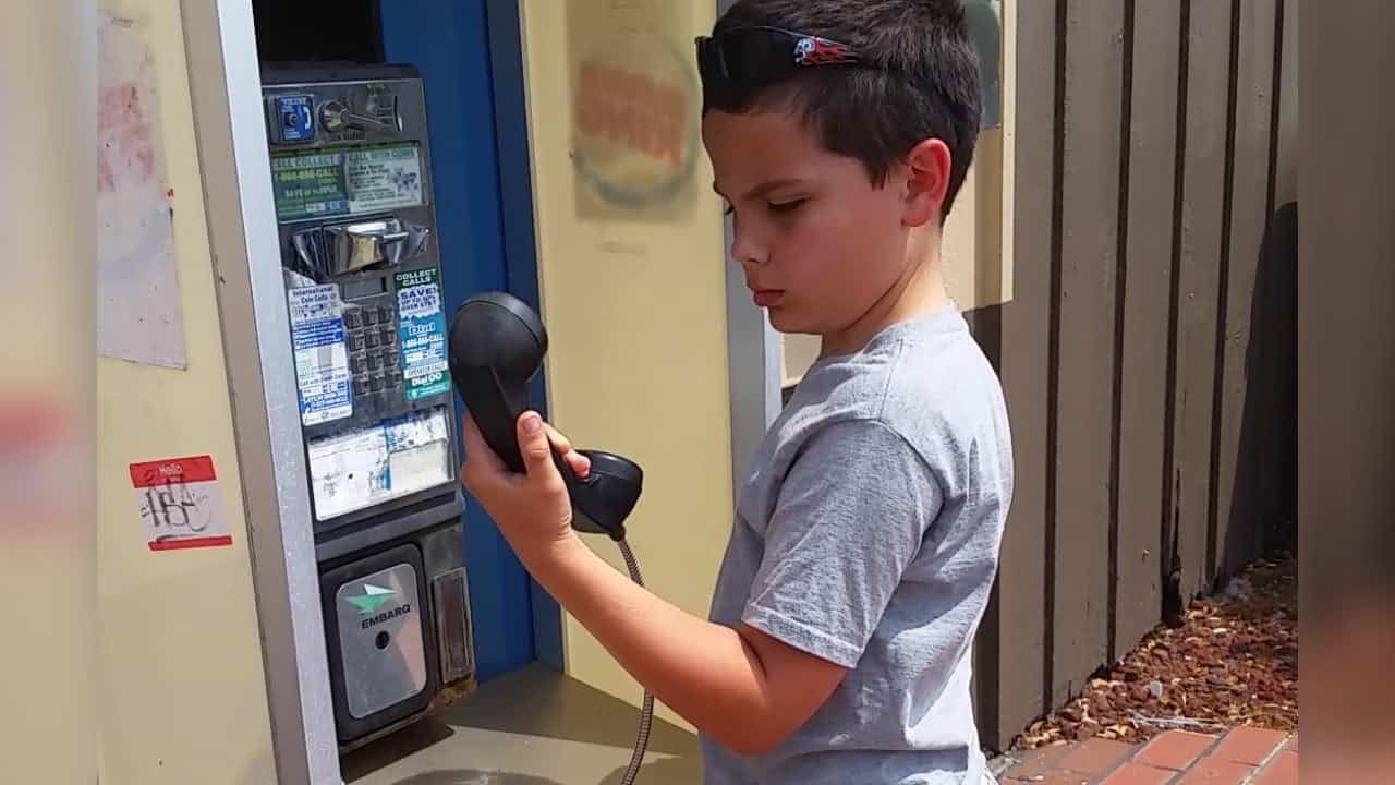 A Kid Sees a Payphone for the First Time, and Has No Idea What It Is